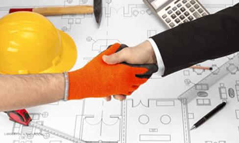 Construction worker shaking hands